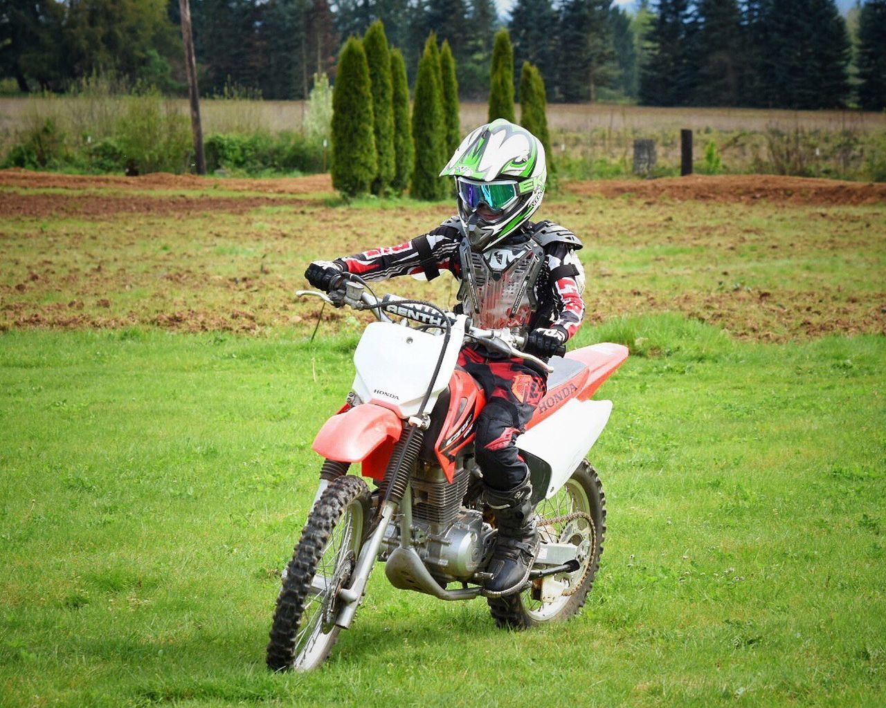 Motorcycle Crash Helmet Grass Biker Motocross Motorcycle Racing Day Outdoors Motorsport Tree One Person People The Great Outdoors - 2017 EyeEm Awards Dirtbike Youth Of Today Youth Culture Childhood Memories Motorsport Competitive Sport Extreme Sports Sports Clothing Real People Field Helmet Sports Helmet