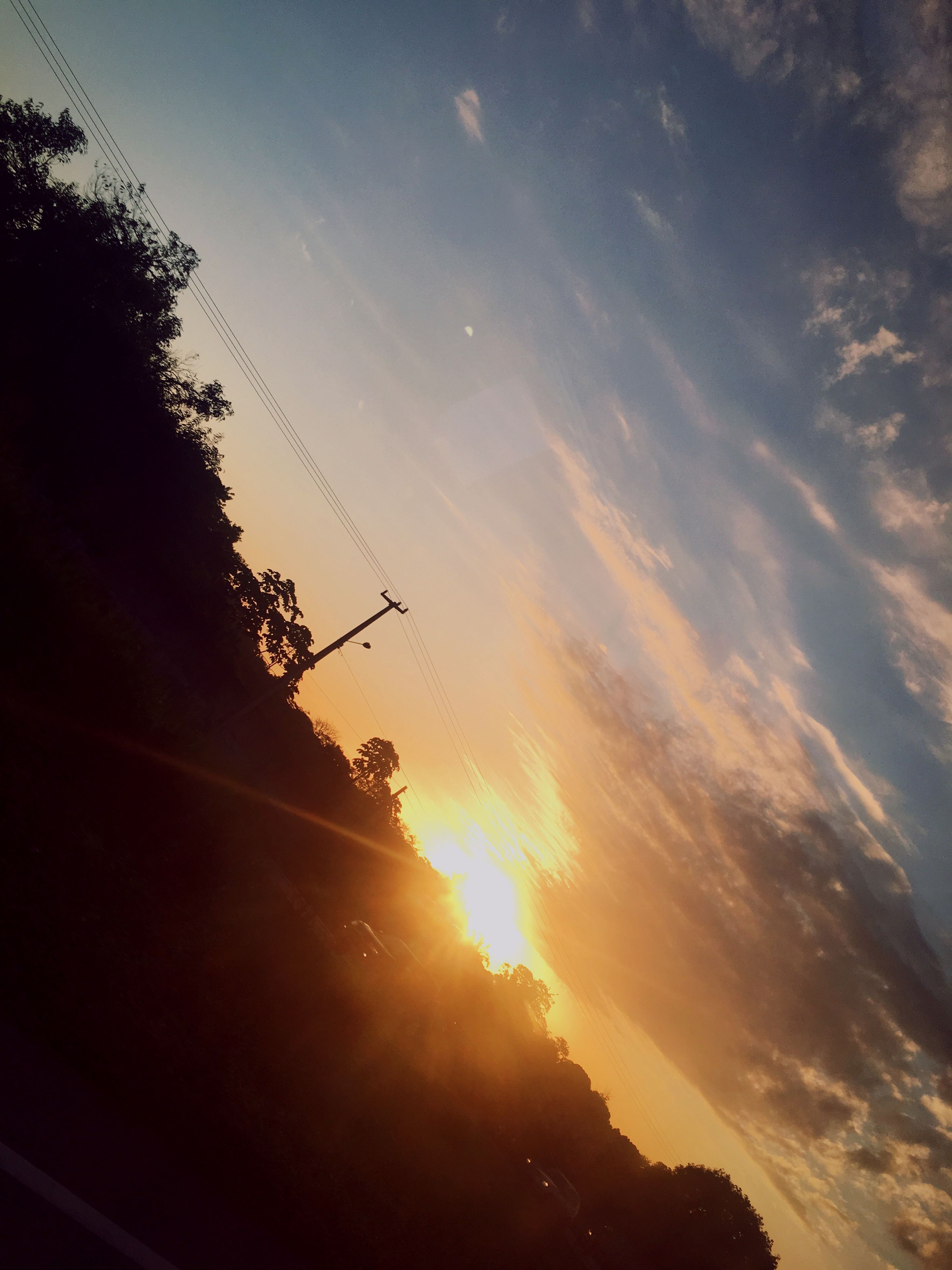 sunset, sky, nature, silhouette, sun, low angle view, sunlight, beauty in nature, outdoors, no people, scenics, tree, day