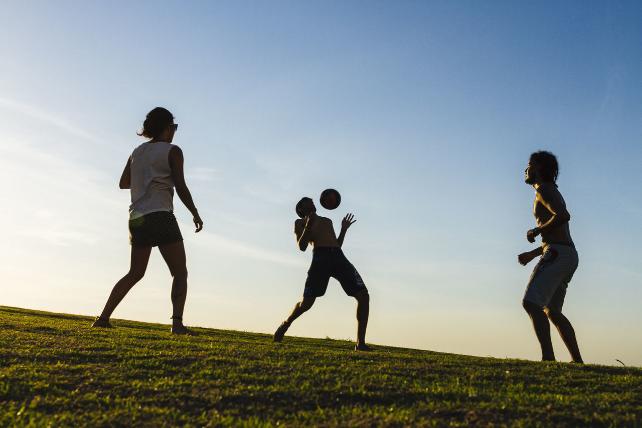 Friends play freestyle soccer in a typical late summer afternoon in Salvador, Bahia Ball Childhood Exercising Friendship Full Length Fun Grass Group Of People Leisure Activity Live For The Story Outdoors People Playing Soccer Soccer Ball Soccer Player Sport