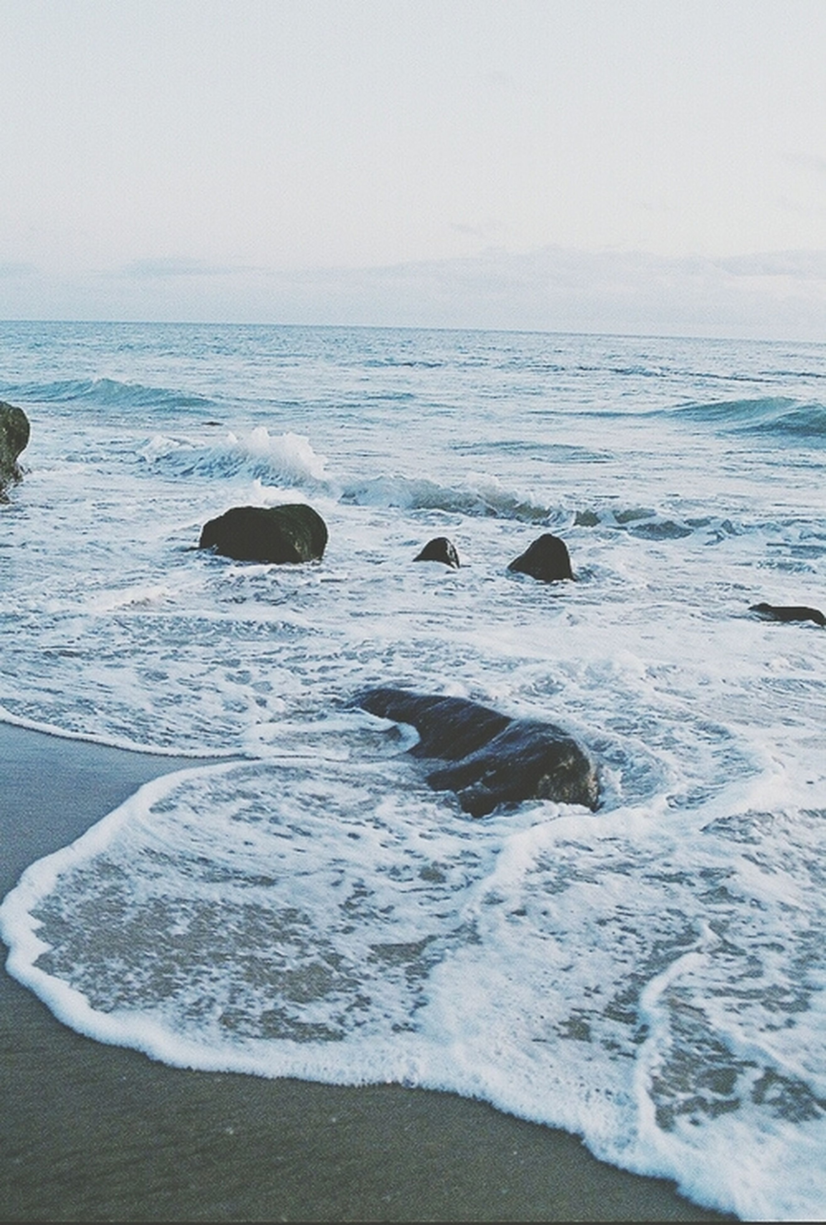 sea, water, beach, horizon over water, shore, wave, scenics, surf, tranquil scene, beauty in nature, tranquility, nature, sand, clear sky, idyllic, sky, copy space, remote, coastline, motion