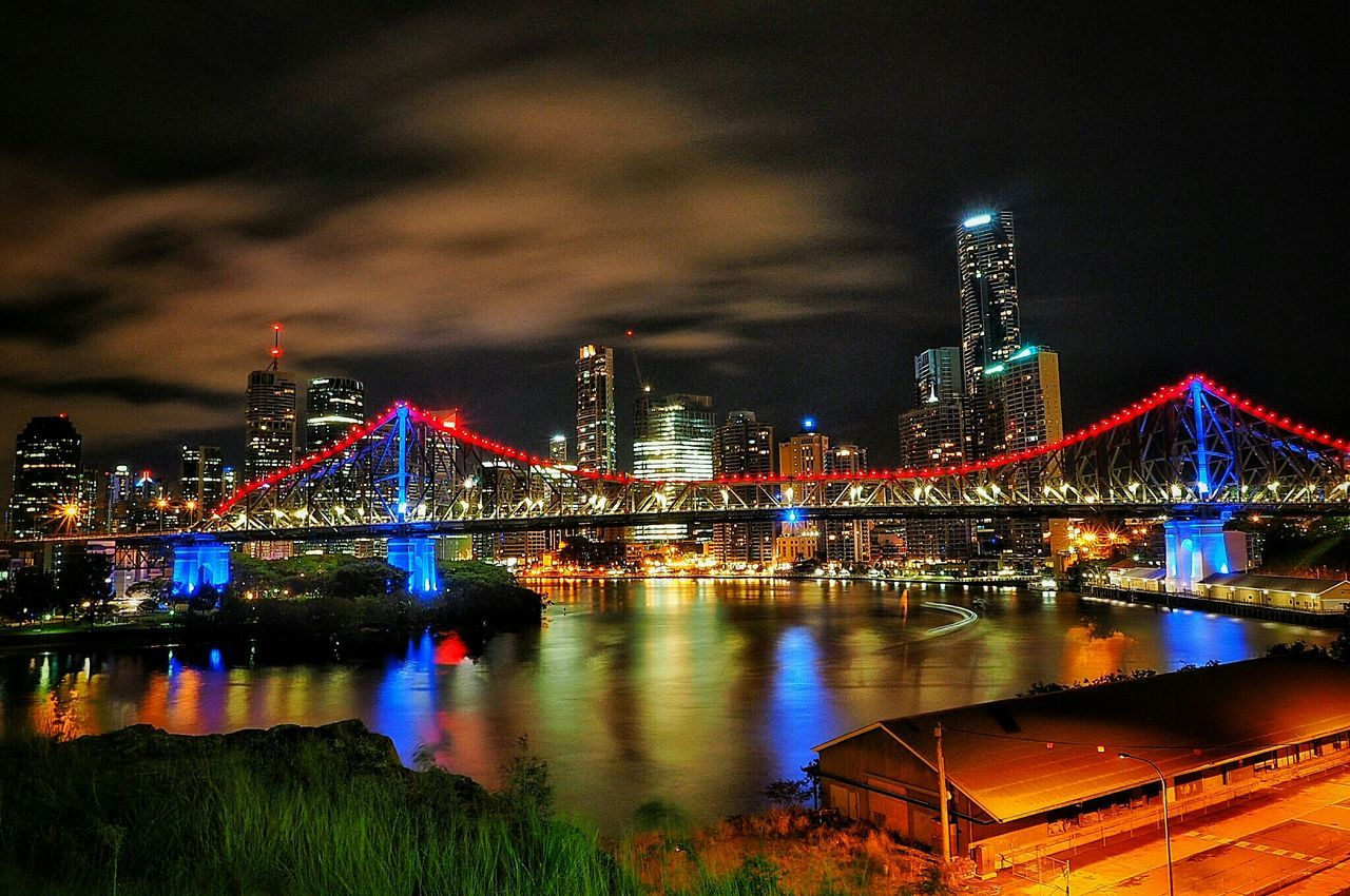 Low Angle View Of Illuminated Story Bridge Over Brisbane River In City Against Sky