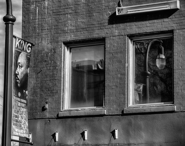 MLK tribute Abandoned Architecture Bad Condition Blackandwhite Brick Wall Building Exterior Built Structure Closed Damaged Day Glass - Material EyeEm Best Shots - Black + White MLK Nikon D750 No People Old Photographyisthemuse Reflections Ruined Streetphotography Tamron 70-200mm F/2.8 Urban Architecture Urbanphotography Wall Window