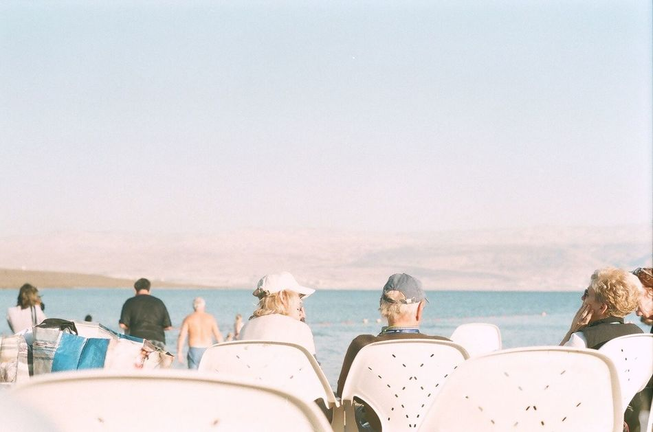 Sea Beach Water Sand Vacations Men Sky Outdoors Real People Women Day Nature Adult People Adults Only Israel Deadsea White White Color Chairs Chair Americans
