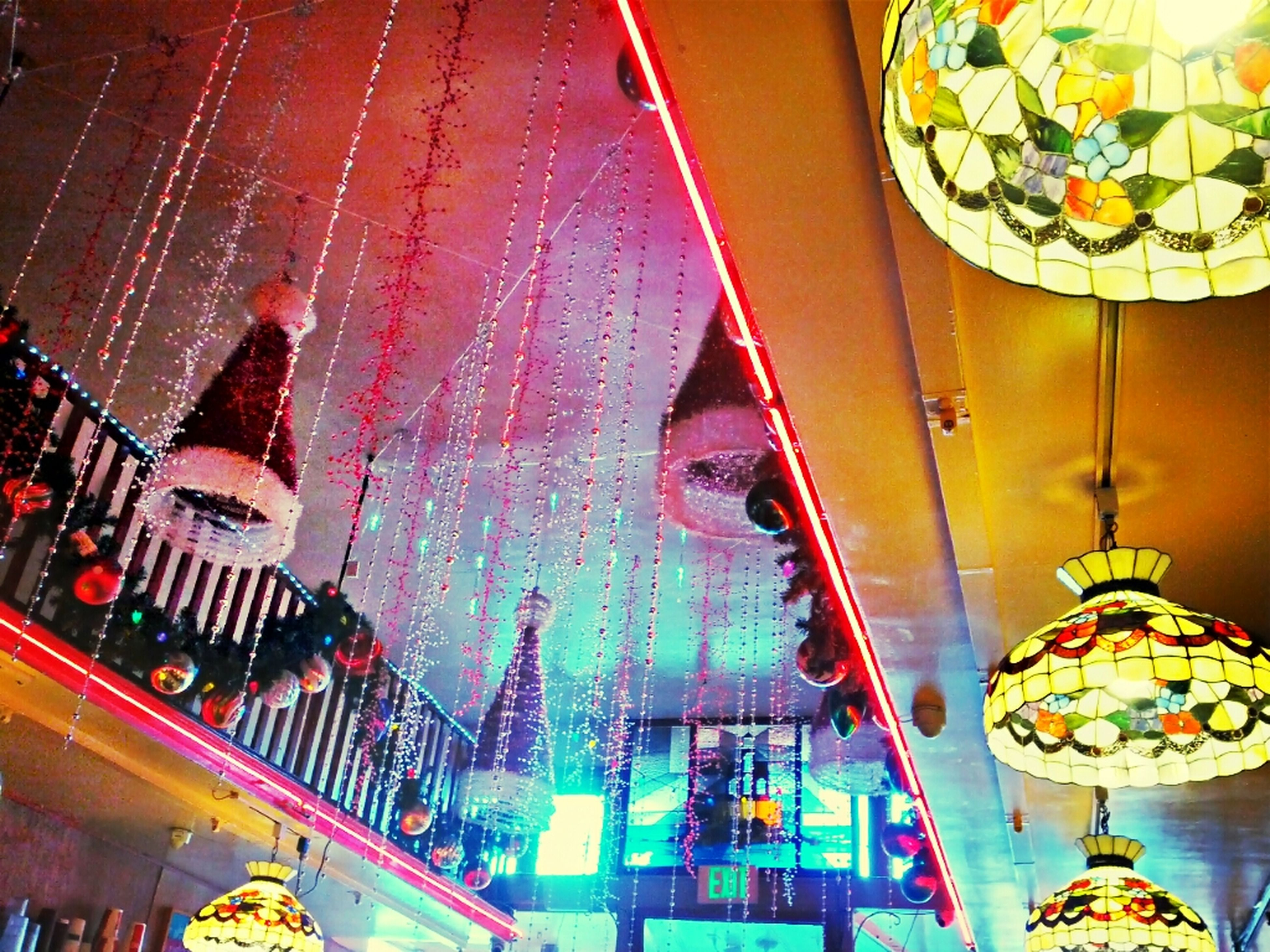 illuminated, low angle view, decoration, multi colored, architecture, built structure, celebration, hanging, arts culture and entertainment, tradition, building exterior, lighting equipment, indoors, cultures, amusement park, night, amusement park ride, ceiling, christmas lights, traditional festival