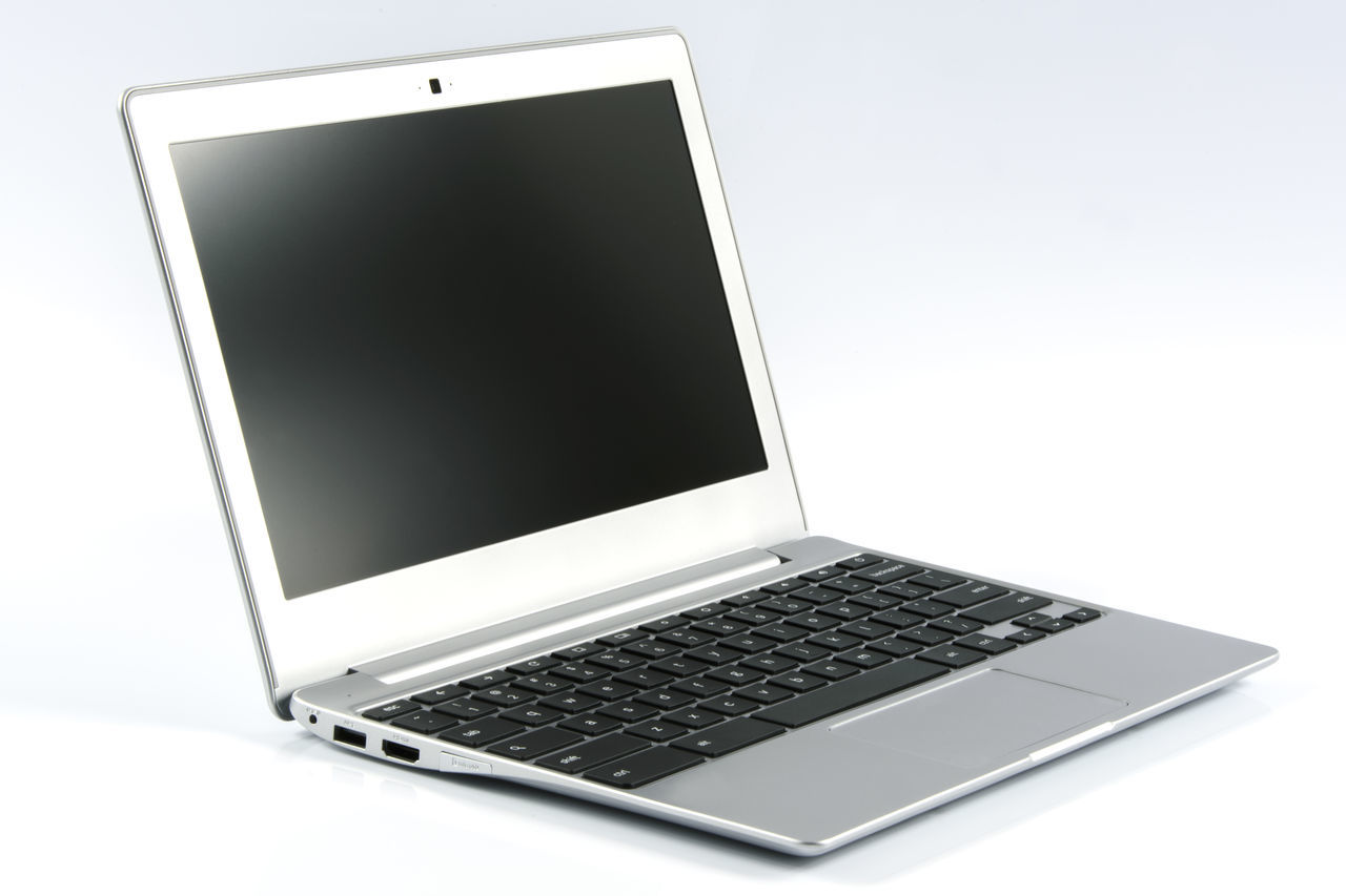 Modern and prestigious laptop. Incredibly elegant metal slimbook isolated on white background. Business Chromebook Communication Computer Computer Keyboard Elegant Internet Isolated Laptop Laptops Manager Metallic Mobile Modern Netbook Notebook Office Portable Pro Screen Silver - Metal Slim Studio Shot Technology Wireless Technology