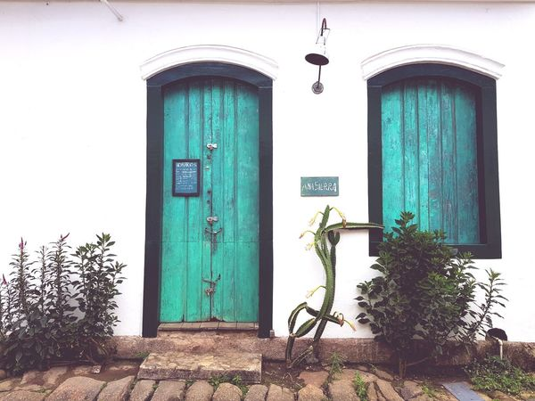 EyeEm Selects Door Architecture Building Exterior Entrance Built Structure Day Outdoors Façade Doorway House No People Whitewashed Flower Downtown District Colors Summertime Window Travel Destinations Architecture Colorful The Week On EyeEm