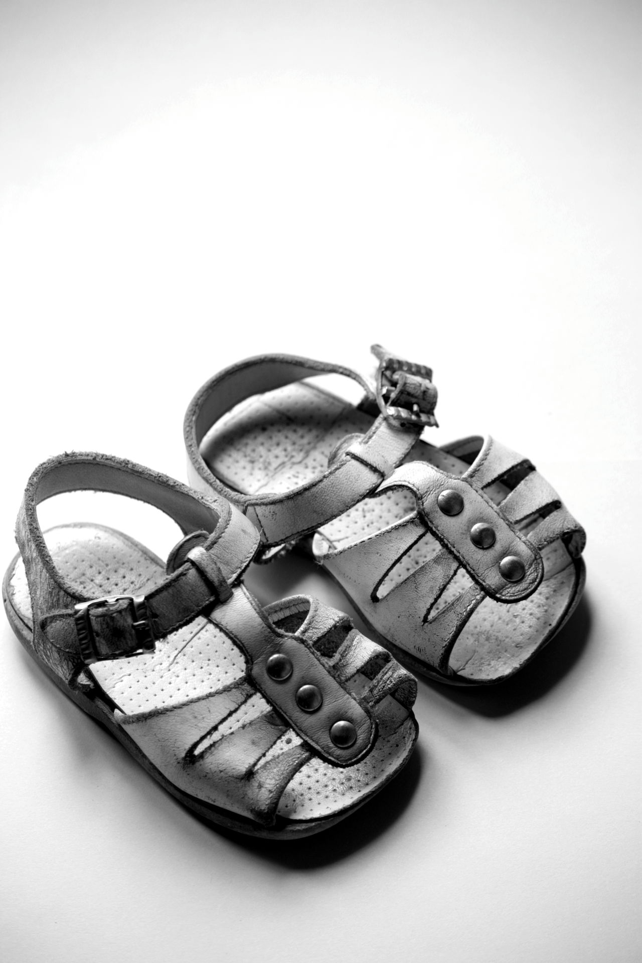 My first pair of shoes Baby Shoes Black And White Black And White Photography Childhood Memories Nostalgia Nostalgic  Old Shoes Retro Styled Sandals Still Life The Past