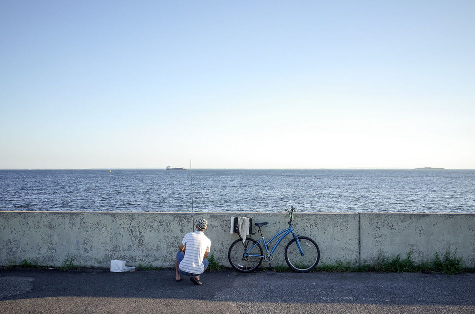 The world seen from behind Backhead Behind Bicycle Escapism Fishing Getting Away From It All Horizon Horizon Over Water Lifestyles Men New York City Ocean Outdoors Rear View Sea Seascape The World Seen From Behind Transportation Water Weekend Activities