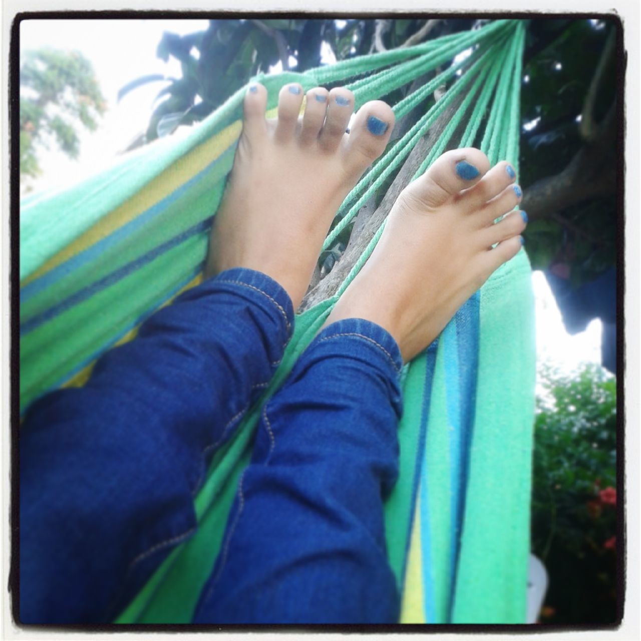 relax on hammock Blue Casual Clothing Day Enamel Feet Hammock Leisure Activity Lifestyles Outdoors Part Of Personal Perspective Relaxation Resting Sitting Teanager Woman