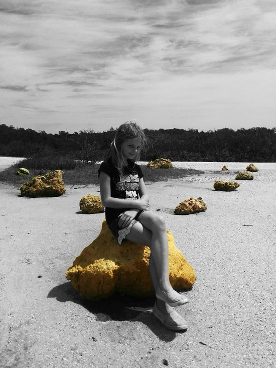 Color Splash Young Girl On The Rocks Blonde Girl Boulders Rocks Rocks And Sand In The Forest Grin Smirk Eye Contact Yellow Stone