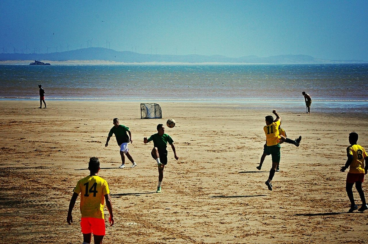 Football Fever Football Game On The Beach Improvised Football Pitch On The Sand Taking Photos Capture The Moment From Where I Stand Malephotographerofthemonth Footballislife Localscene Local Culture Football Time  Football Field By The Sea People Photography Playing Football Having Fun Football Is Here - Essaouira Morocco