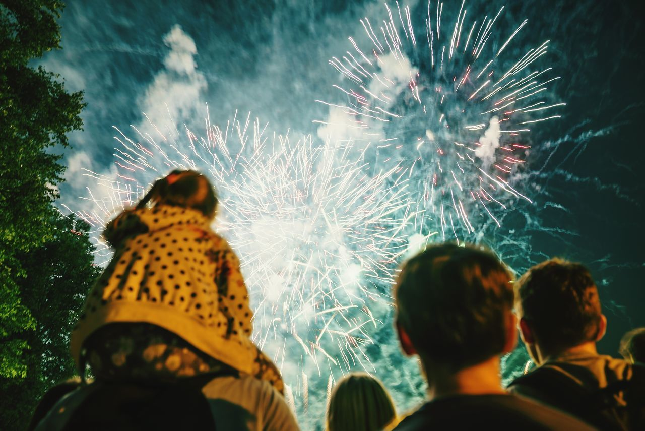 Celebration Night Firework Display Event Rear View Adult Watching People Multi Colored Lifestyles Togetherness Women Men Outdoors Illuminated Defocused Adults Only Sky Close-up