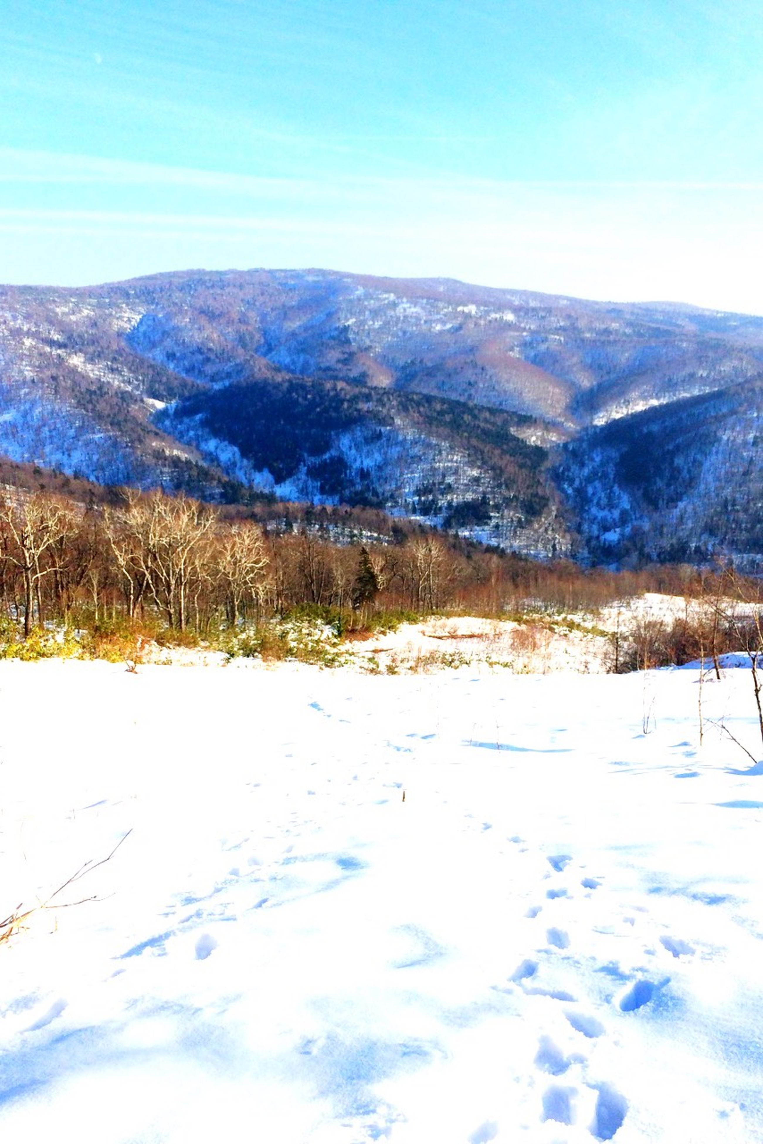 snow, mountain, winter, cold temperature, tranquil scene, landscape, tranquility, mountain range, scenics, beauty in nature, season, nature, clear sky, non-urban scene, sky, covering, field, blue, snowcapped mountain, weather