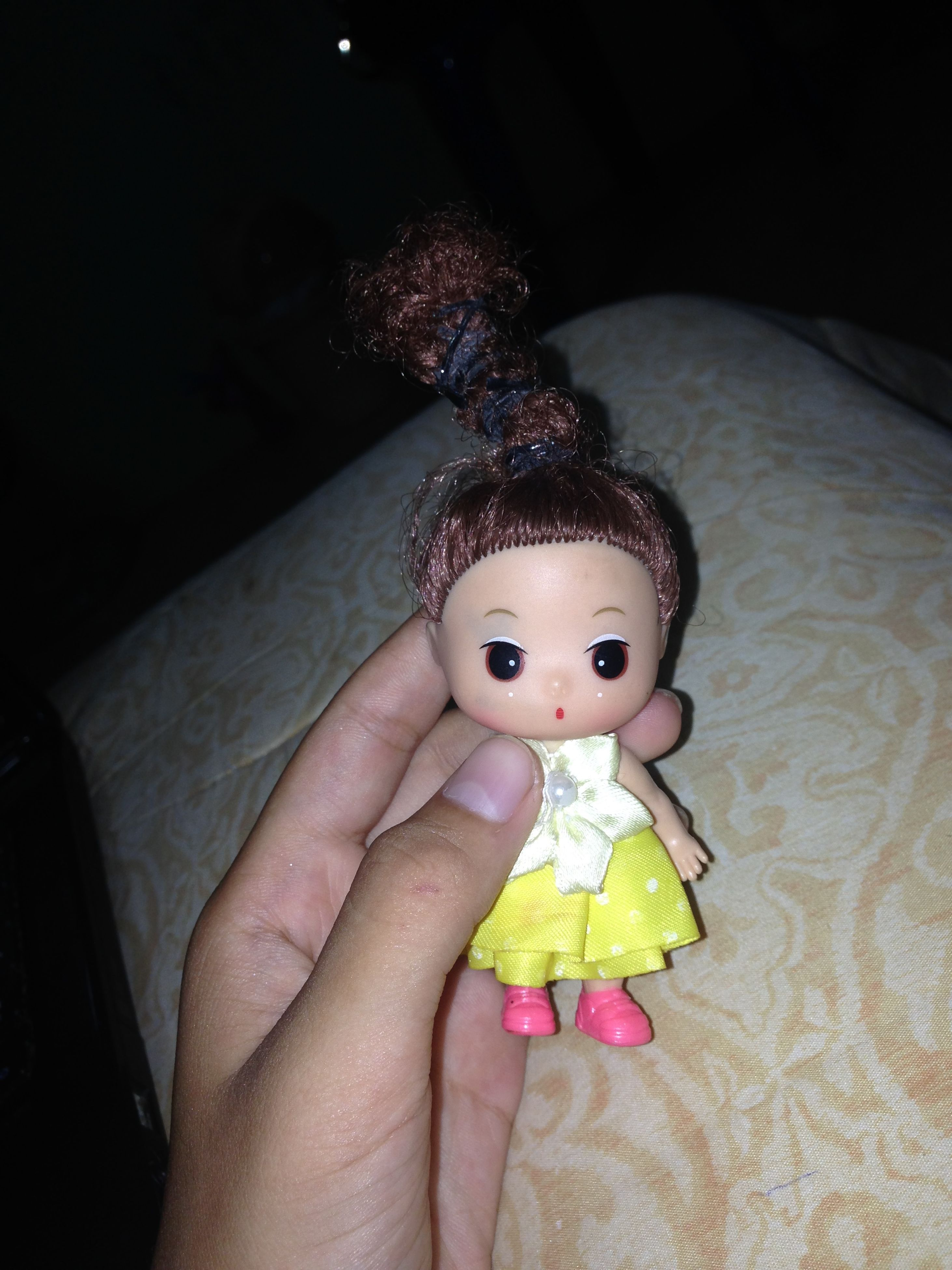 person, indoors, holding, creativity, art, art and craft, toy, animal representation, close-up, part of, human finger, human representation, high angle view, multi colored, craft, cropped, wood - material