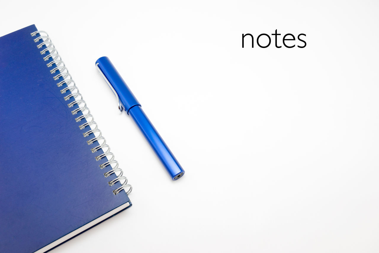 Word Notes with notebook and pen in white isolated background Action Plan Blue Checklist Close-up Education Idea Isolated White Background No People Note Pad Notebook NotePad Notes Office Supply Pen Stationary Still Life Studio Shot White White Background