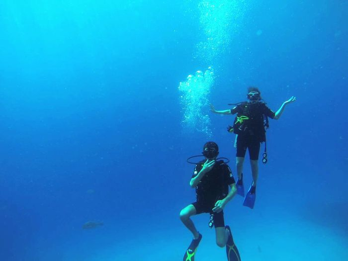 Scuba Diving Underwater Sea UnderSea Exploration Two People Travel Blue Adventure Travel Destinations People Leisure Activity Underwater Diving Togetherness Nature Bubble Water Sea Life Vacations Real People