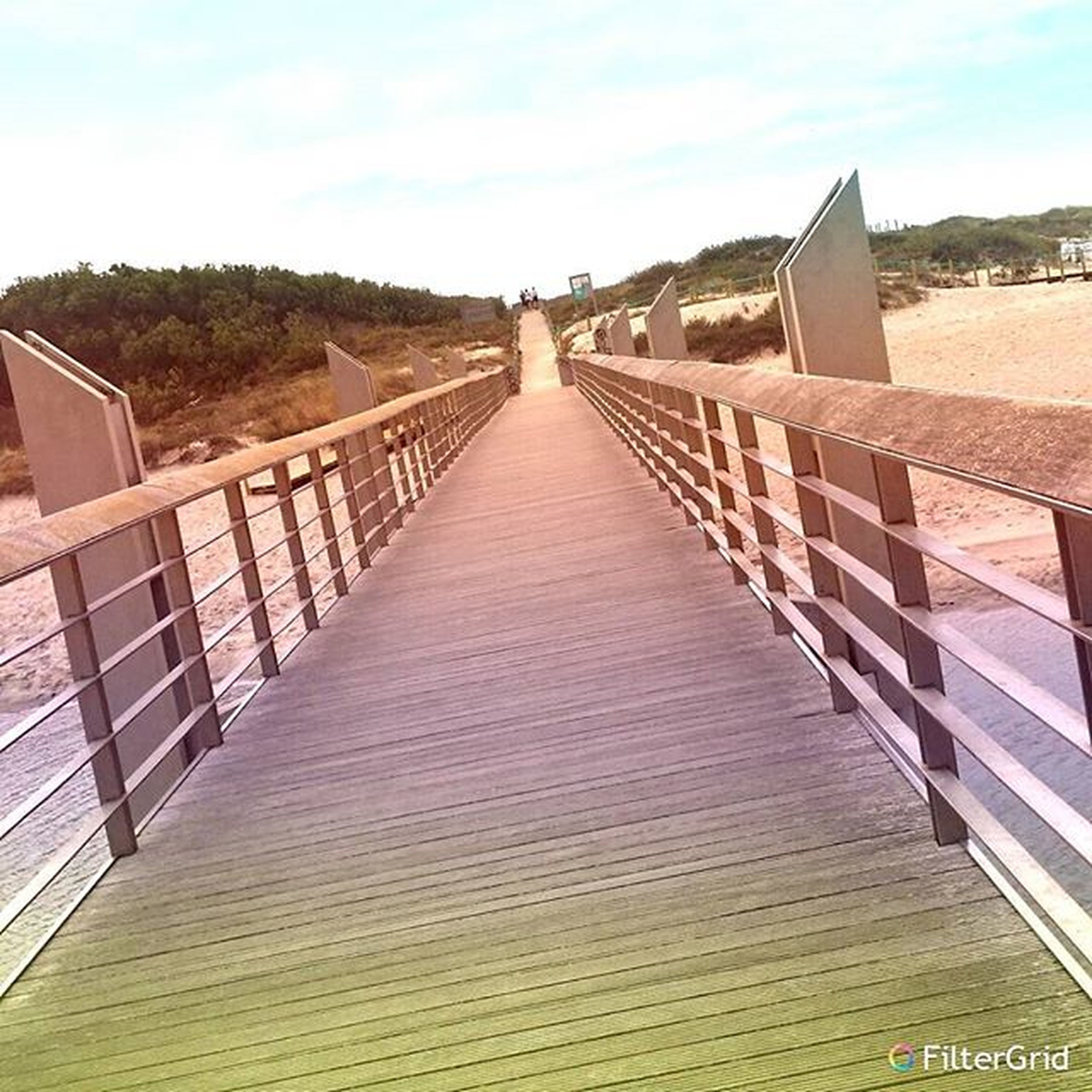 built structure, architecture, the way forward, railing, diminishing perspective, building exterior, sky, connection, footbridge, boardwalk, bridge - man made structure, vanishing point, wood - material, long, sunlight, outdoors, day, bridge, walkway, no people