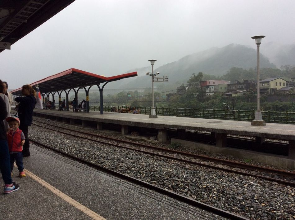 Architecture Day Mountain One Person Outdoors Public Transportation Rail Transportation Railroad Station Railroad Station Platform Railroad Track Real People Sky Transportation Women