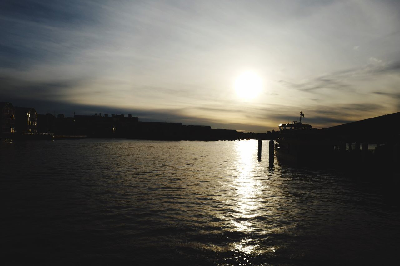 Sunset Water Sun Sky Silhouette Waterfront Sunlight Reflection Cloud - Sky Outdoors Sea No People Architecture Nature Scenics Beauty In Nature Building Exterior City Day