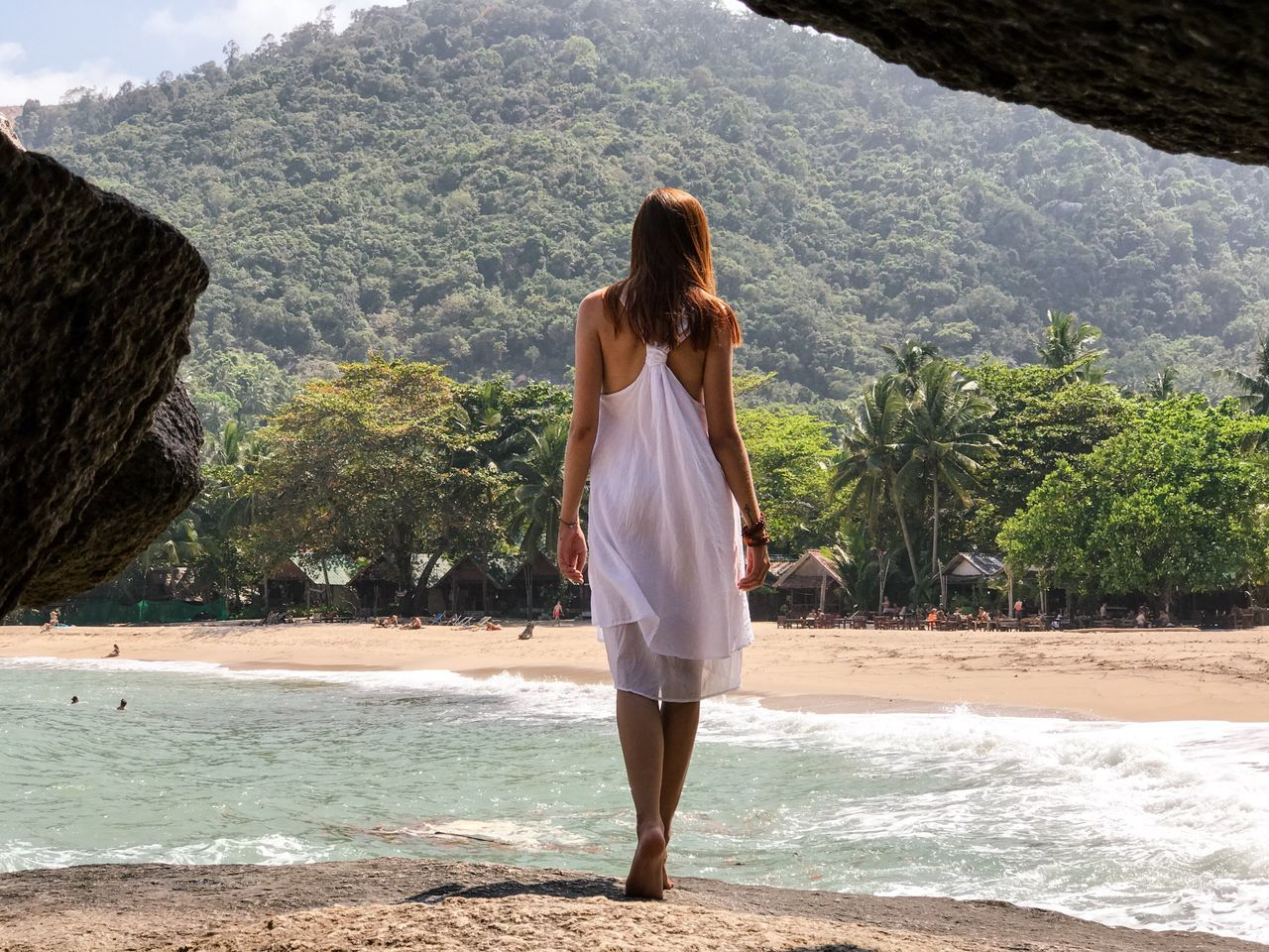 Vacations White Dress Rear View Beach One Person Only Women Beauty In Nature Young Adult Summer Long Hair The Great Outdoors - 2017 EyeEm Awards Tranquility Standing Adults Only Tranquil Scene One Woman Only Mountain Sand Water Travel Destinations Rock - Object Rock Formation Sea Thailand Cave