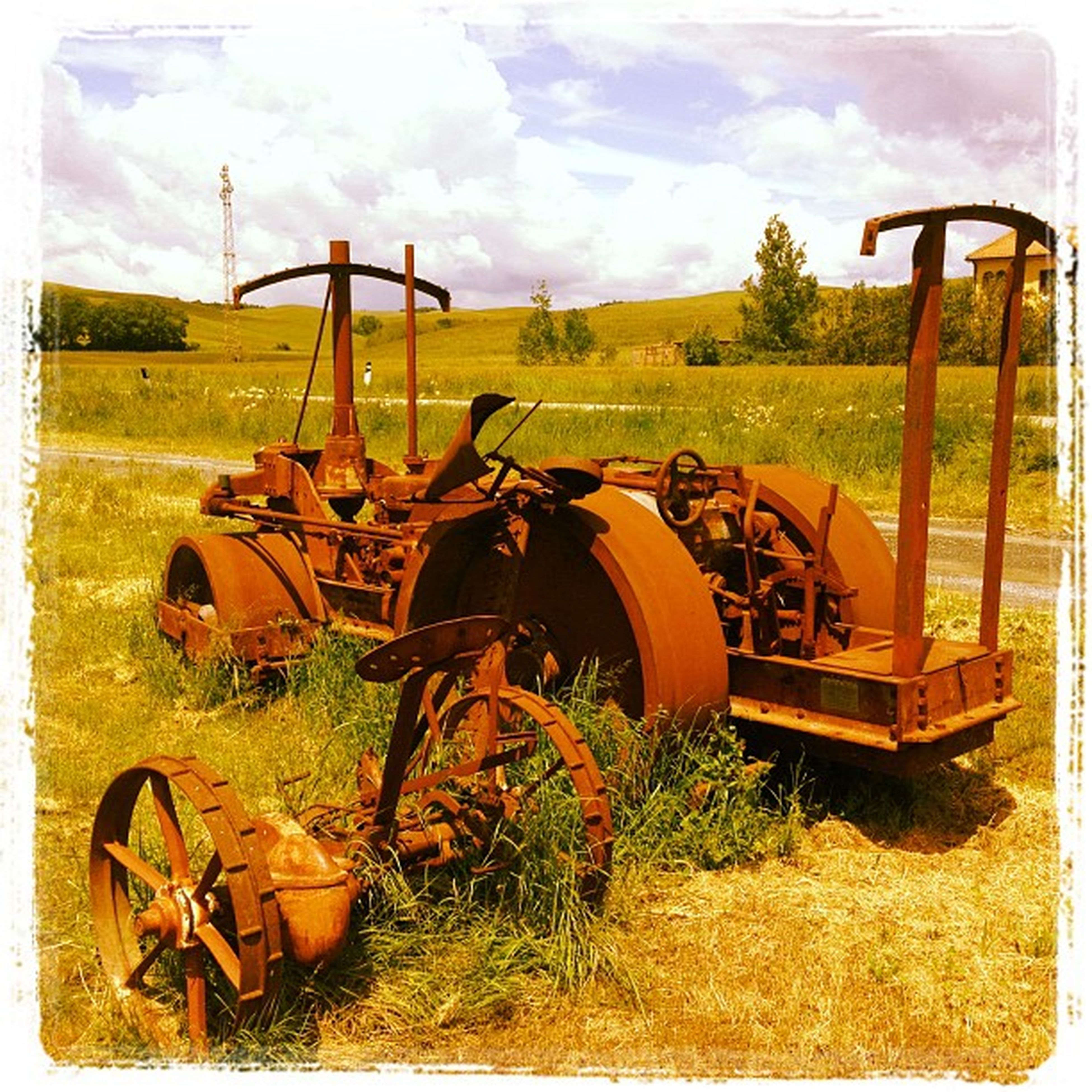 transfer print, auto post production filter, mode of transport, field, transportation, agriculture, sky, land vehicle, rural scene, tractor, farm, grass, cloud - sky, abandoned, stationary, outdoors, agricultural machinery, landscape, plant, day