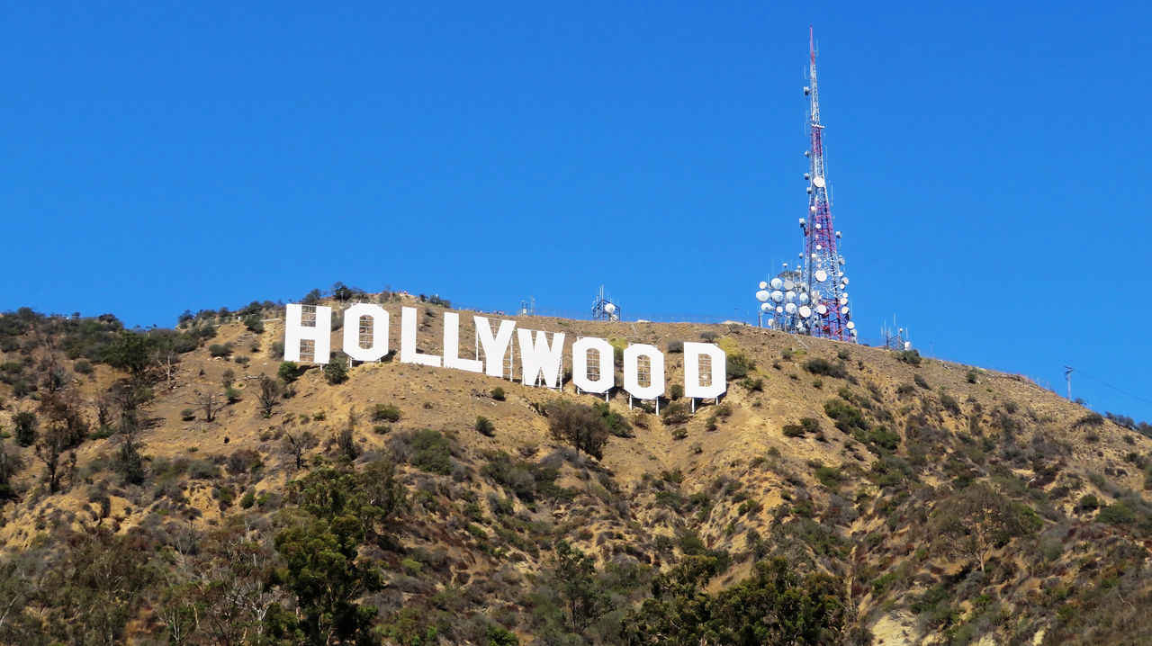 Hollywood Sign America Architecture Blue Built Structure California Day Famous Places Film Industry Hollywood Sign Mountain No People Outdoors Sunny Text