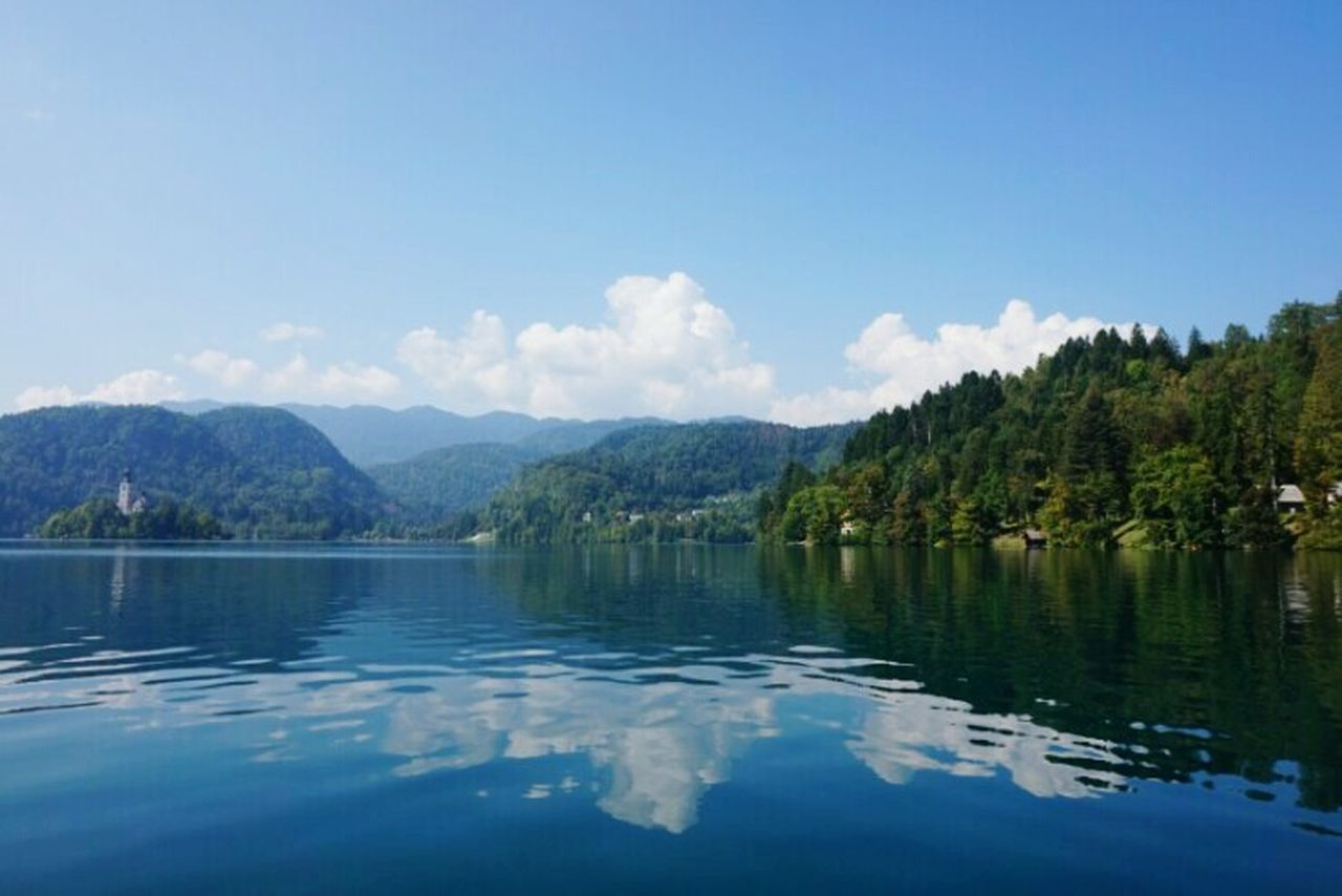 mountain, reflection, sky, lake, scenics, water, nature, tree, tranquil scene, tranquility, beauty in nature, waterfront, mountain range, outdoors, cloud - sky, no people, day, landscape, blue