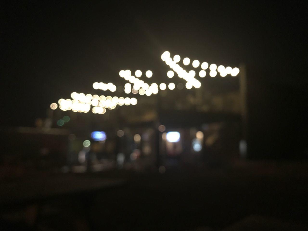 Blurred outdoor nightlife. Illuminated Night Defocused Dark No People City Close-up Outdoors Lights Nightlife