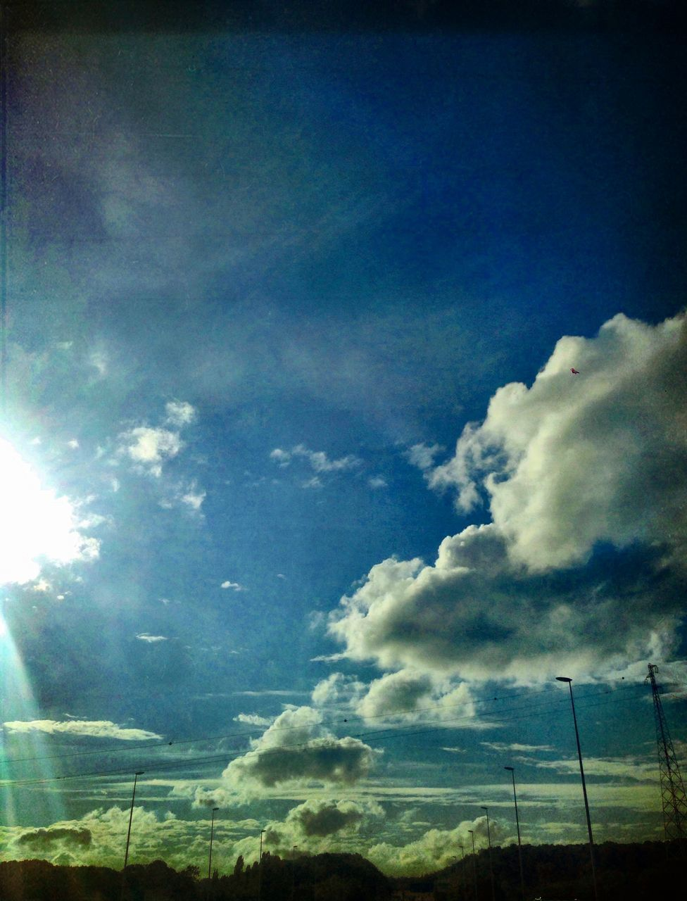 sky, low angle view, no people, nature, beauty in nature, day, tranquility, scenics, cloud - sky, outdoors, blue