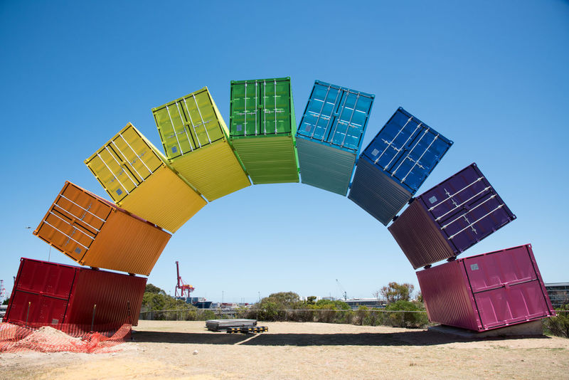 Unique vibrant rainbow painted shipping container sculpture public installation by Marcus Canning on beach reserve in Fremantle, Western Australia. Abstract Arch Archway Art Art Installation ArtWork Beach Reserve Built Structure Colorful Conceptual Fremantle  Marcus Canning Pattern Rainbow Repetition Sculpture Sea Container Shipping Containers Unique Urban Art Vibrant Color Visual Expression Vivid Western Australia Whimsical