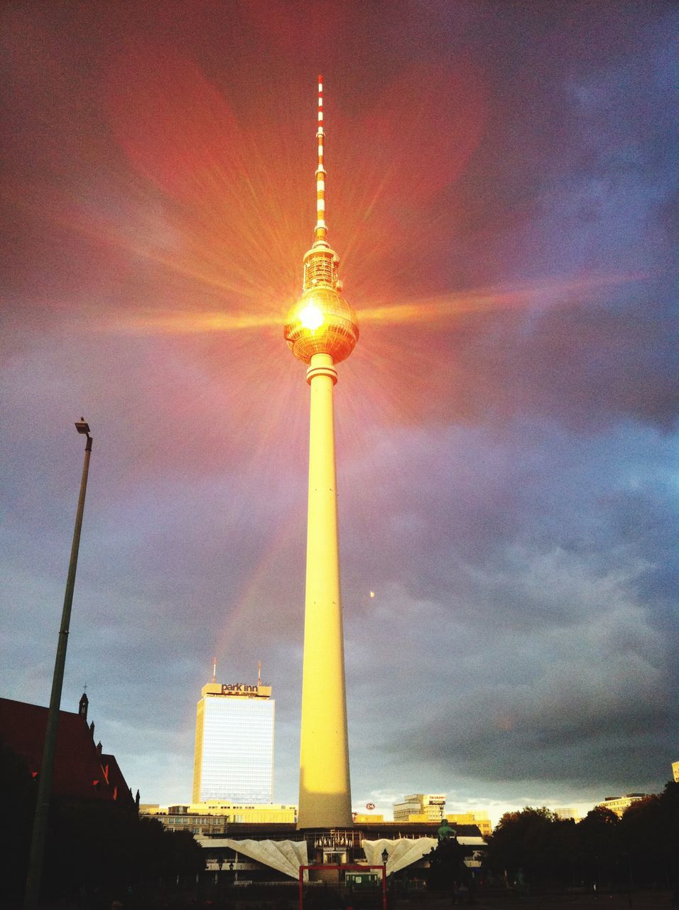 LOW ANGLE VIEW OF FERNSEHTURM TOWER AGAINST CLOUDY SKY