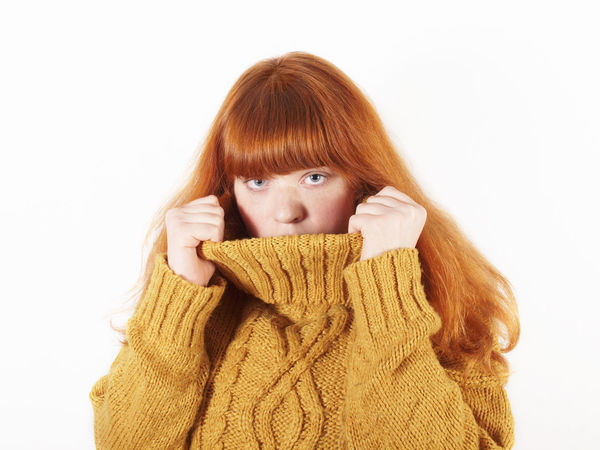 Embarrassment Redhead Woman Adult Coyness Girl Hide Hiding Looking At Camera One Person People Portrait Real People Red Hair Rollneck Shy Studio Shot Young Adult