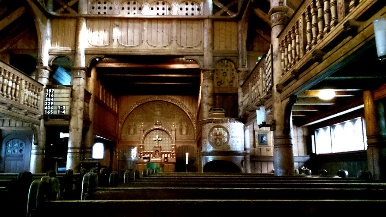 indoors, religion, spirituality, place of worship, pew, arch, built structure, architectural column, architecture, low angle view, no people, day, illuminated, altar