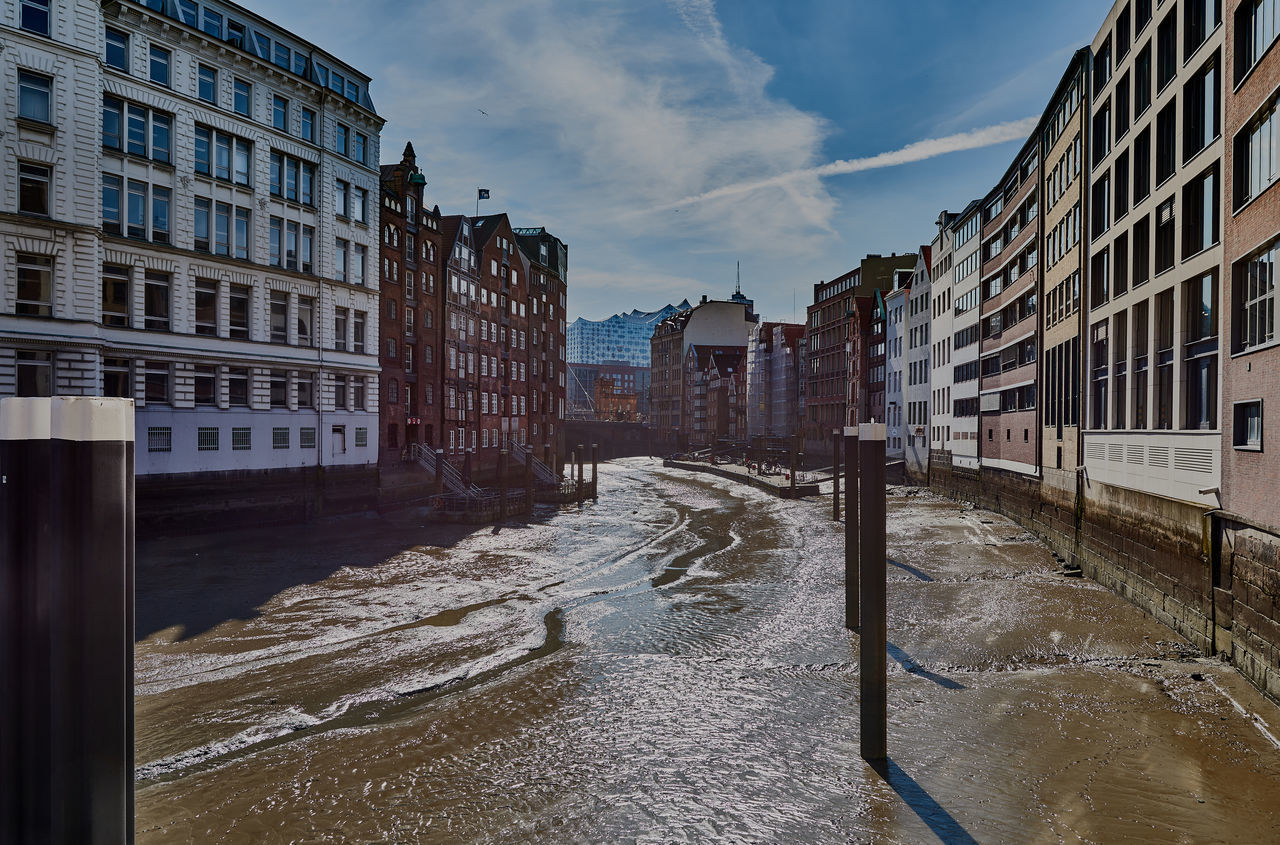 HAMBURG, GERMANY - MARCH 26, 2016: A dry waterway during low tide allows a deep view into the architecture of the buildings Hamburg Harbor Landscape Low Tide Hi M Outdoors Place To Visit Tourism Travel Destnations Water Waterway