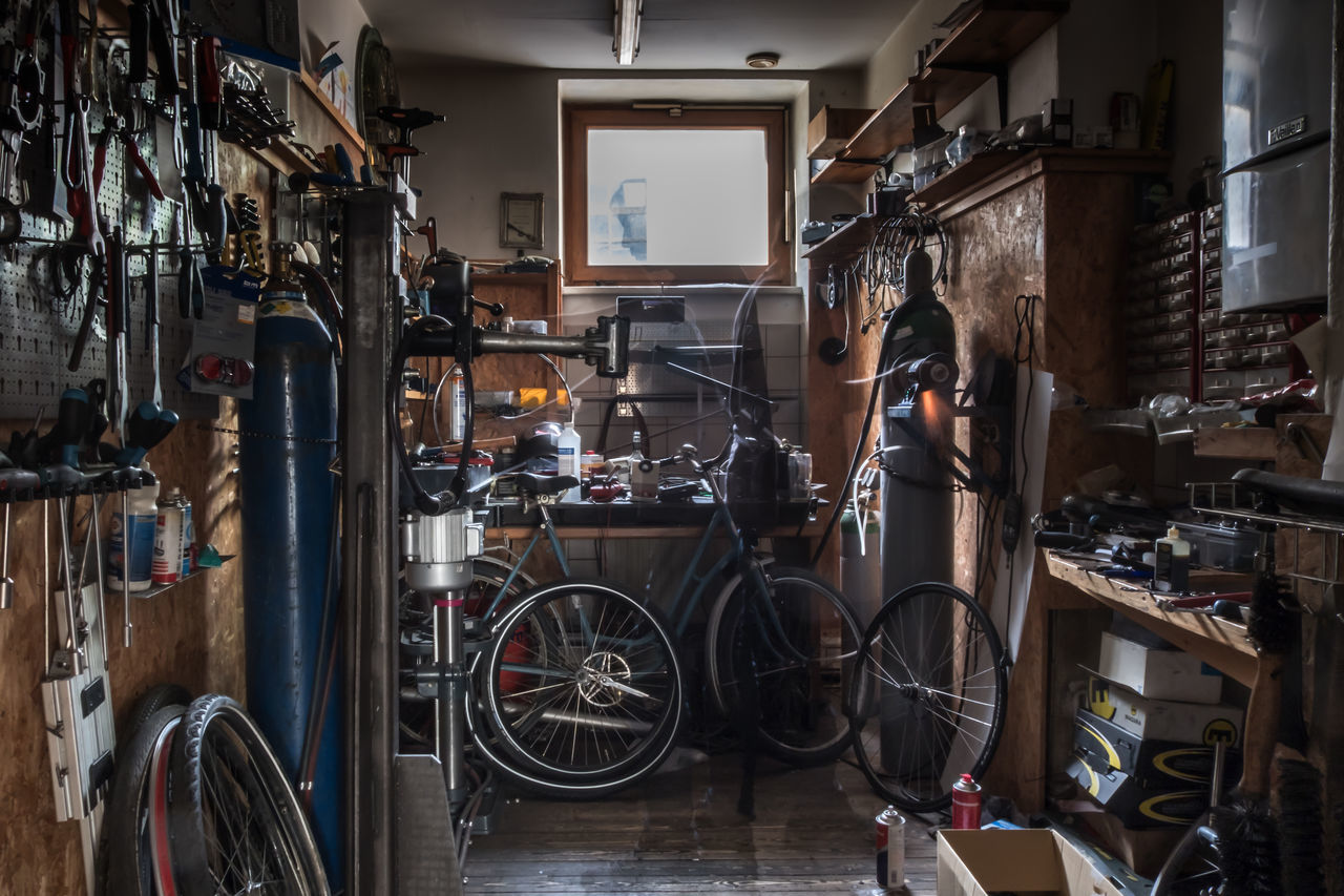 bicycle, indoors, bicycle shop, connection, cable, technology, real people, workshop, repair shop, one person, day