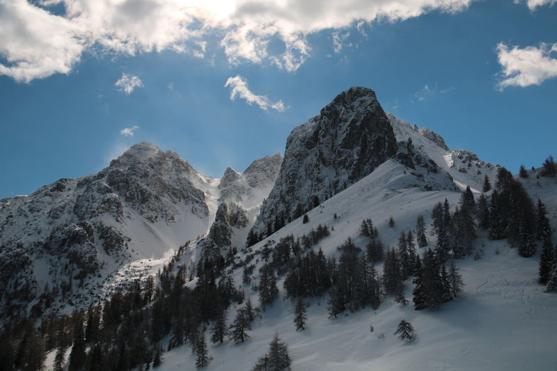 Mountain Peak Mountain Dramatic Sky Winter Outdoors Landscape Snow Forest No People Cold Temperature Close-up Miles Away Pinaceae Pine Tree Pine Woodland Up In Clouds Austrian Alps 3XSPUnity Details The Secret Spaces The Great Outdoors - 2017 EyeEm Awards Distance View Perspectives On Nature
