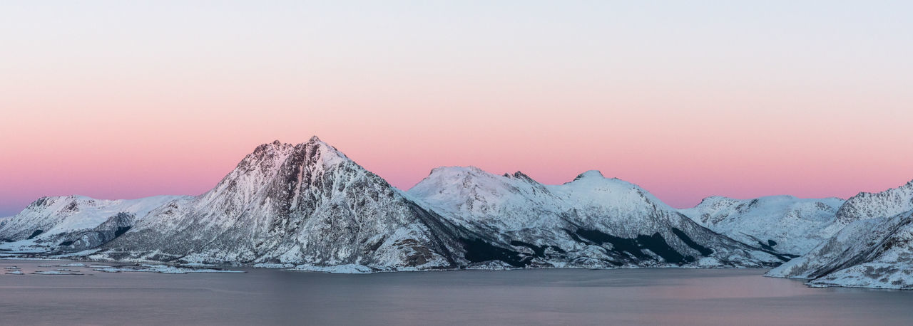 Beauty Beauty In Nature Cold Temperature Day Frozen Ice Landscape Mountain Nature No People Norway Outdoors Panoramic Pastel Power Pink Color Purity Scenics Sea Sky Snow Solid Sunset Vesterålen Water Winter