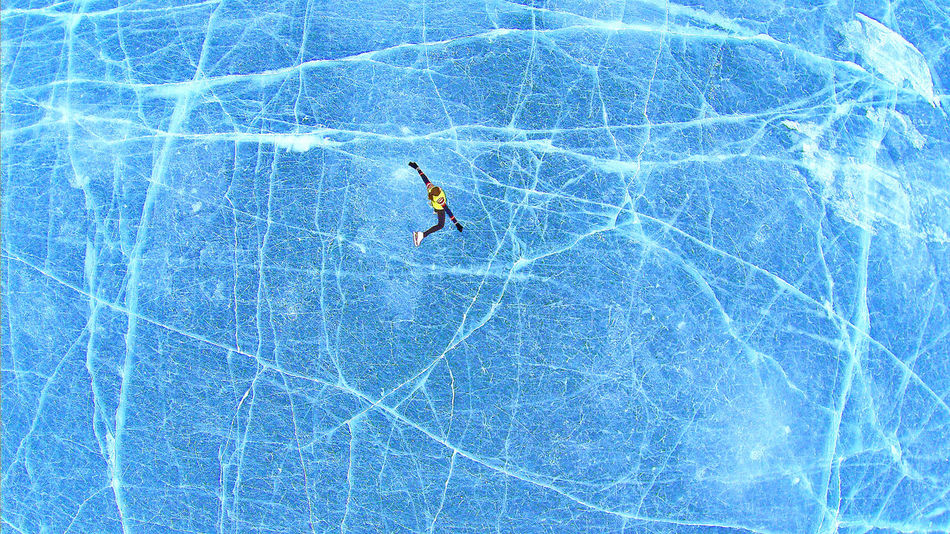 """Top down Aerial drone view of Kate, """"Tsuna"""", skates on Lake of The Isles in Minneapolis, Minnesota USA. Aerial Aerial Photography Day Drone  Ice Lake Nature One Person Outdoors Real People Skate Top Down Tsuna"""