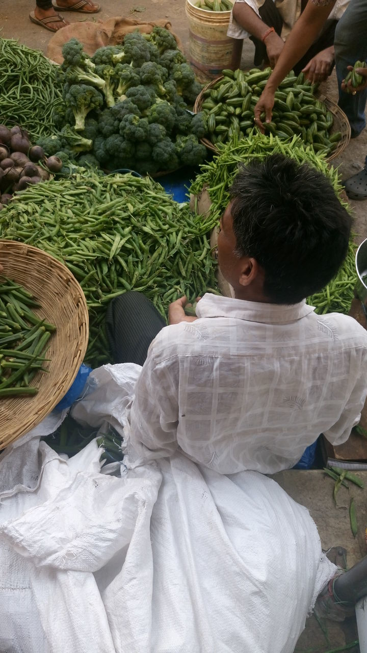 real people, basket, vegetable, freshness, market, food and drink, casual clothing, outdoors, for sale, day, boys, food, choice, retail, variation, childhood, lifestyles, two people, healthy eating, men