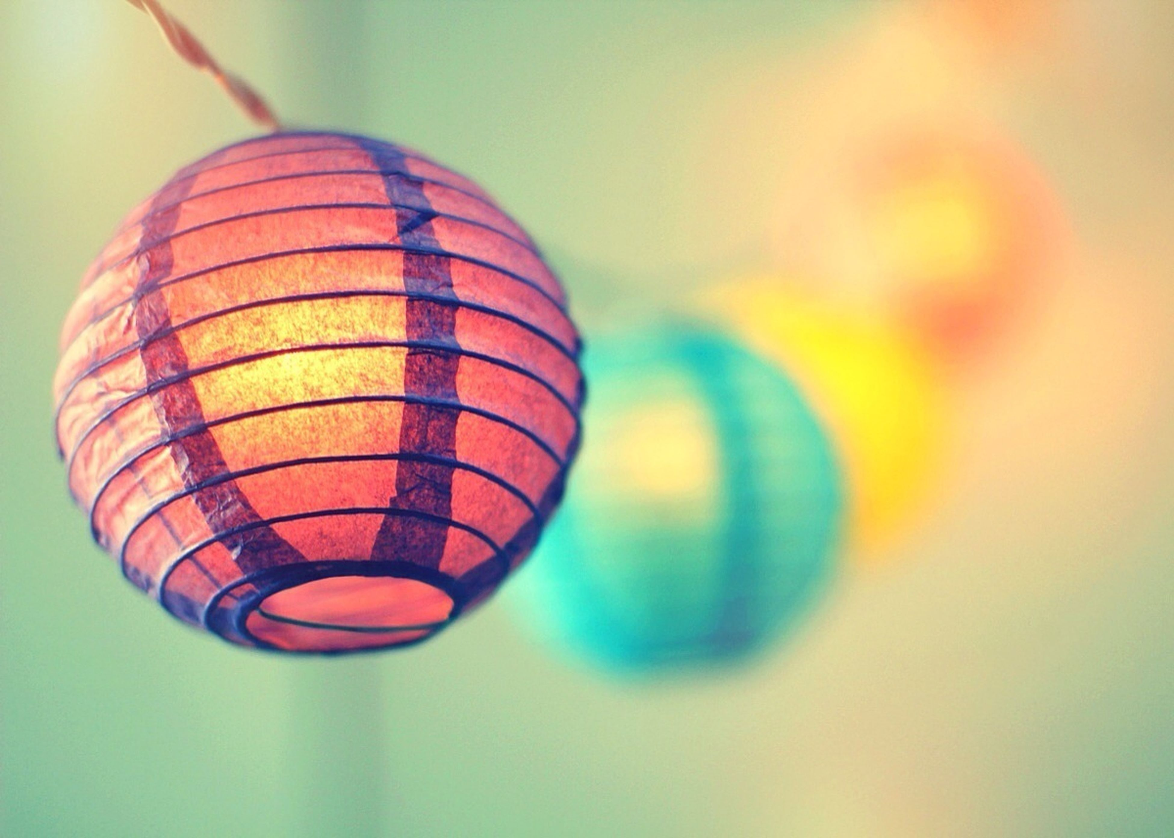 multi colored, sphere, mid-air, close-up, low angle view, balloon, hot air balloon, circle, lighting equipment, geometric shape, pattern, focus on foreground, indoors, decoration, illuminated, hanging, shape, colorful, ball, no people
