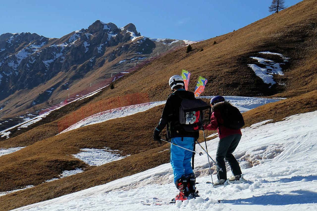 Learning how to ski // Mountain Adventure Backpack Real People Rear View Leisure Activity Winter Mountain Range Cold Temperature Snow Nature Lifestyles Scenics Day Beauty In Nature Vacations Travel Full Length Outdoors Landscape Sunlight Snowcapped Mountain Sky Activity Travel Destinations Healthy Lifestyle Sport Warm Clothing People FUJIFILM X-T10 XF18-55mmF2.8-4 R LM OIS Iso 200 F/21.9 1/85 Sec via Fotofall
