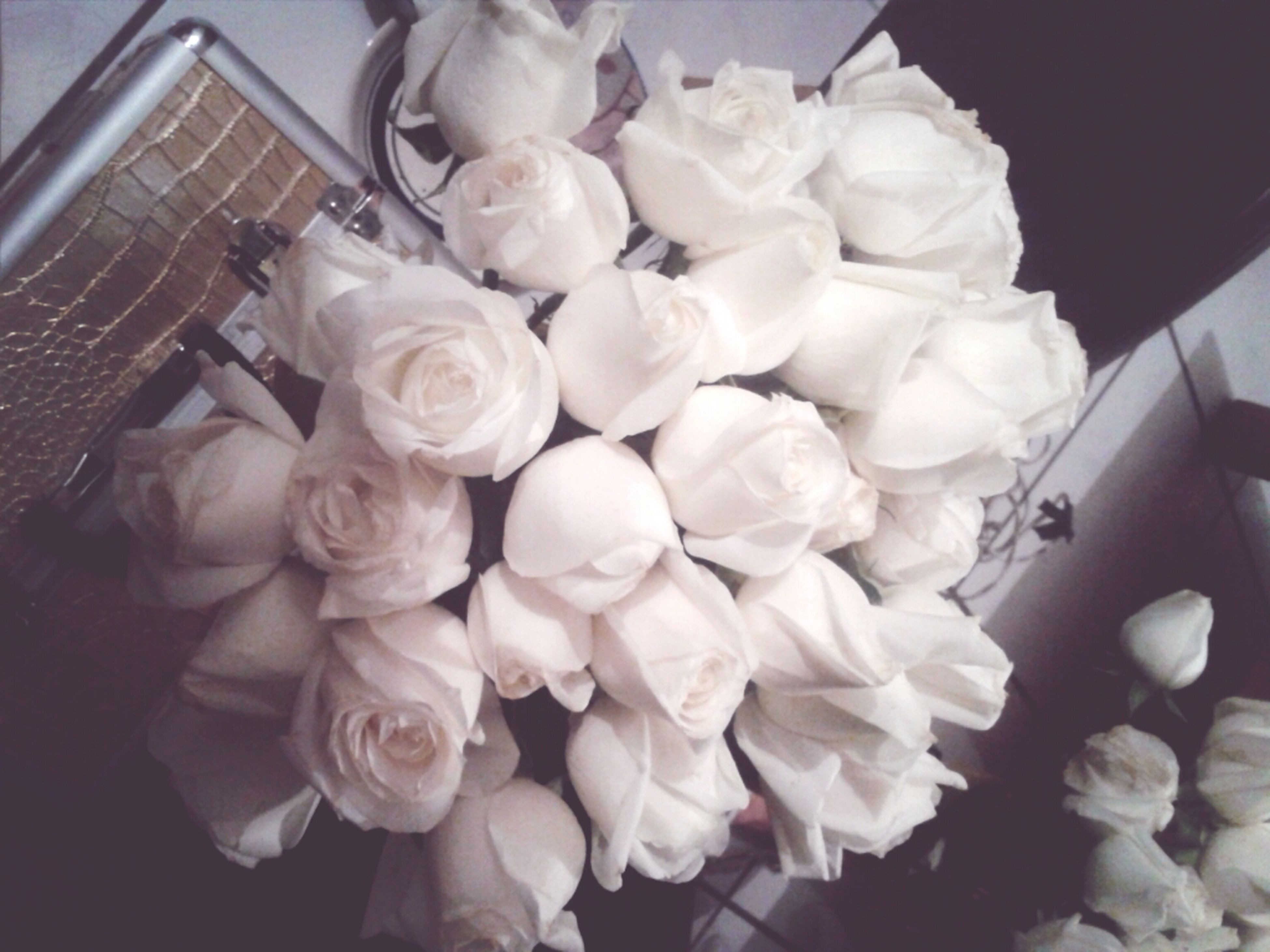 indoors, freshness, flower, high angle view, still life, table, petal, fragility, rose - flower, close-up, bouquet, vase, food and drink, bunch of flowers, flower head, no people, white color, food, decoration, variation