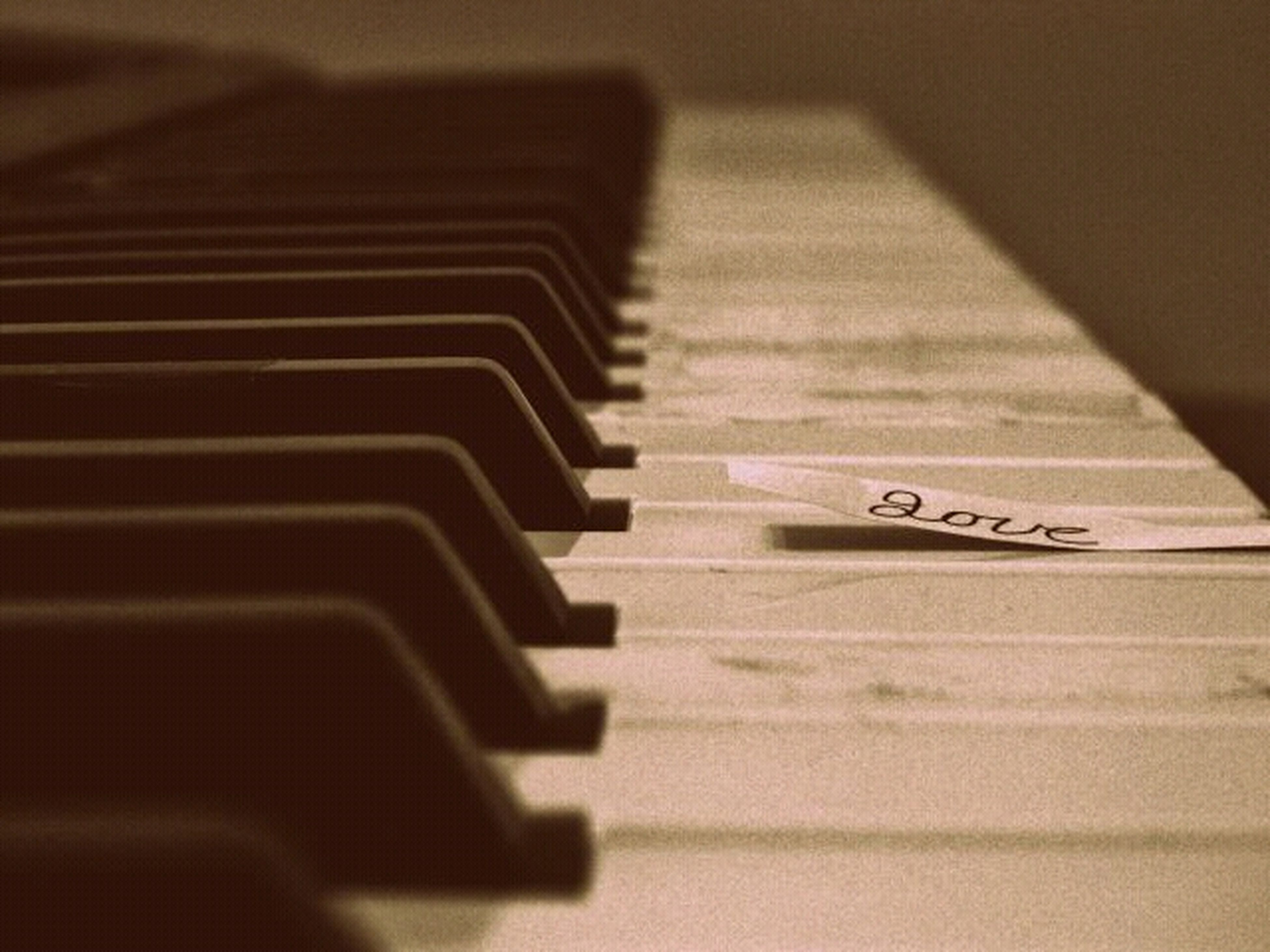 indoors, music, selective focus, piano key, close-up, musical instrument, arts culture and entertainment, piano, musical equipment, in a row, high angle view, still life, technology, no people, absence, surface level, table, empty, focus on foreground, repetition