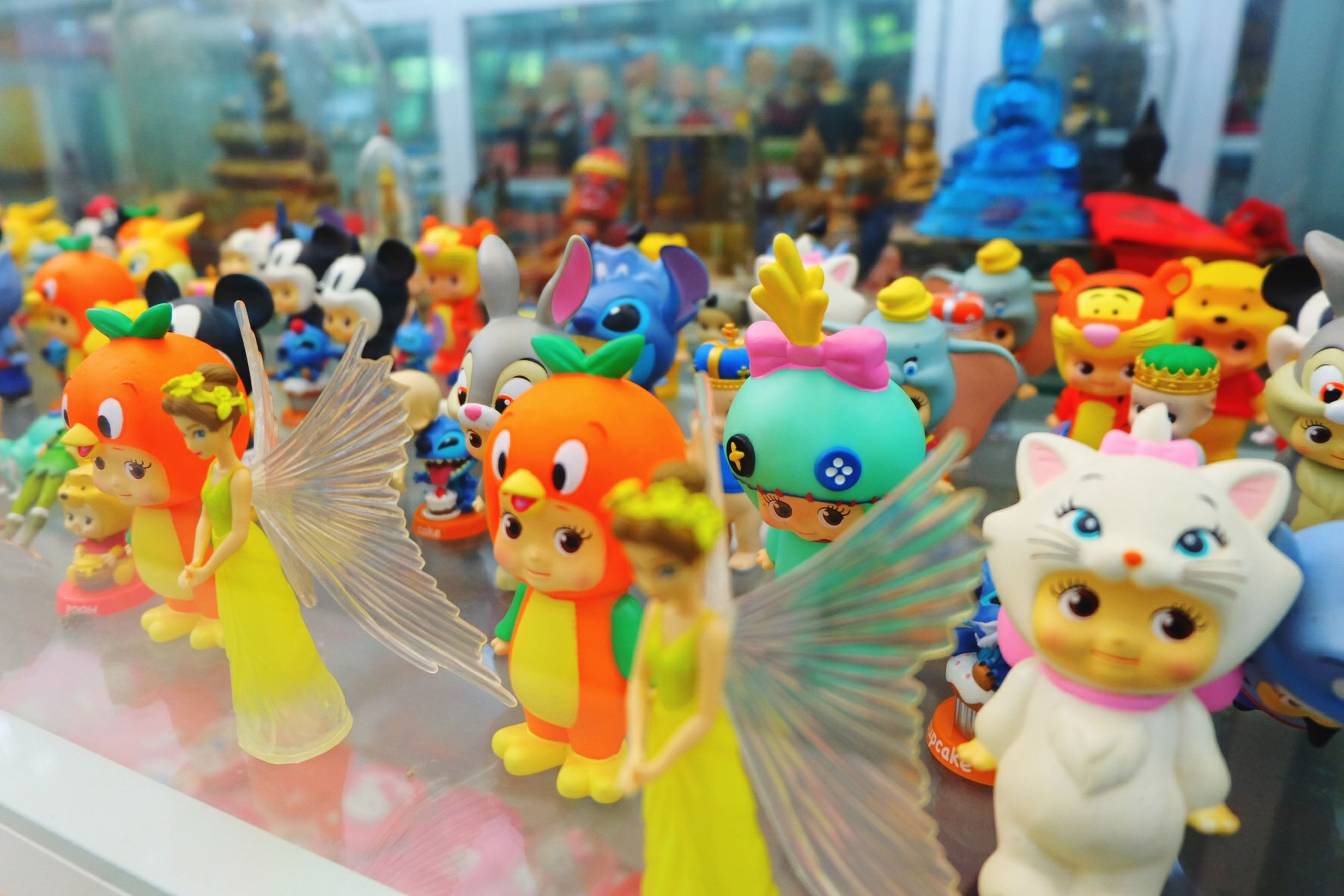 multi colored, toy, childhood, animal representation, indoors, focus on foreground, variation, colorful, art and craft, incidental people, selective focus, creativity, animal themes, art, close-up, cute, elementary age, human representation, choice, stuffed toy