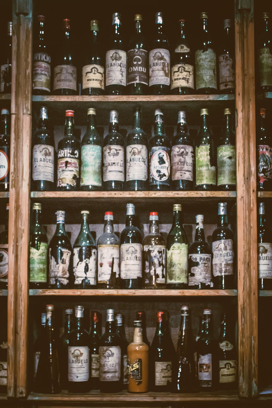"""Bar Notable """"La Poesía"""", San Telmo, Buenos Aires Abundance Alcohol Arrangement Bottle Choice Day Drink Food Food And Drink For Sale In A Row Indoors  Large Group Of Objects Liqueur No People Order Retail  Shelf Shelves Variation"""