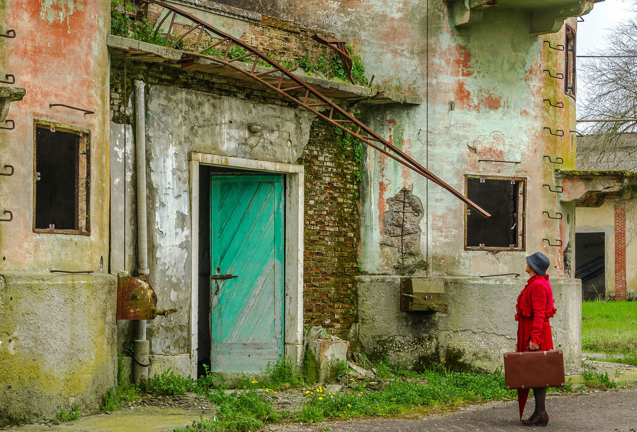 Looking for home ... Architecture Building Exterior Window One Person Real People House Adult Red Umbrella Gildo Masini One Woman Only Hard Beauty Light Live Street Light LollyLove Red Photo Adult Fuji X-T1 Old Building  Allabandoned