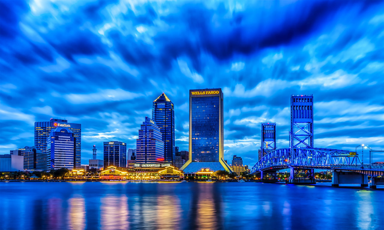 Downtown Jacksonville Architecture Blue City Cityscape Cloudy Dramatic Sky HDR JacksonvilleFL Long Exposure Overcast Reflection Sky Urban Skyline Water Waterfront Weather Colour Of Life