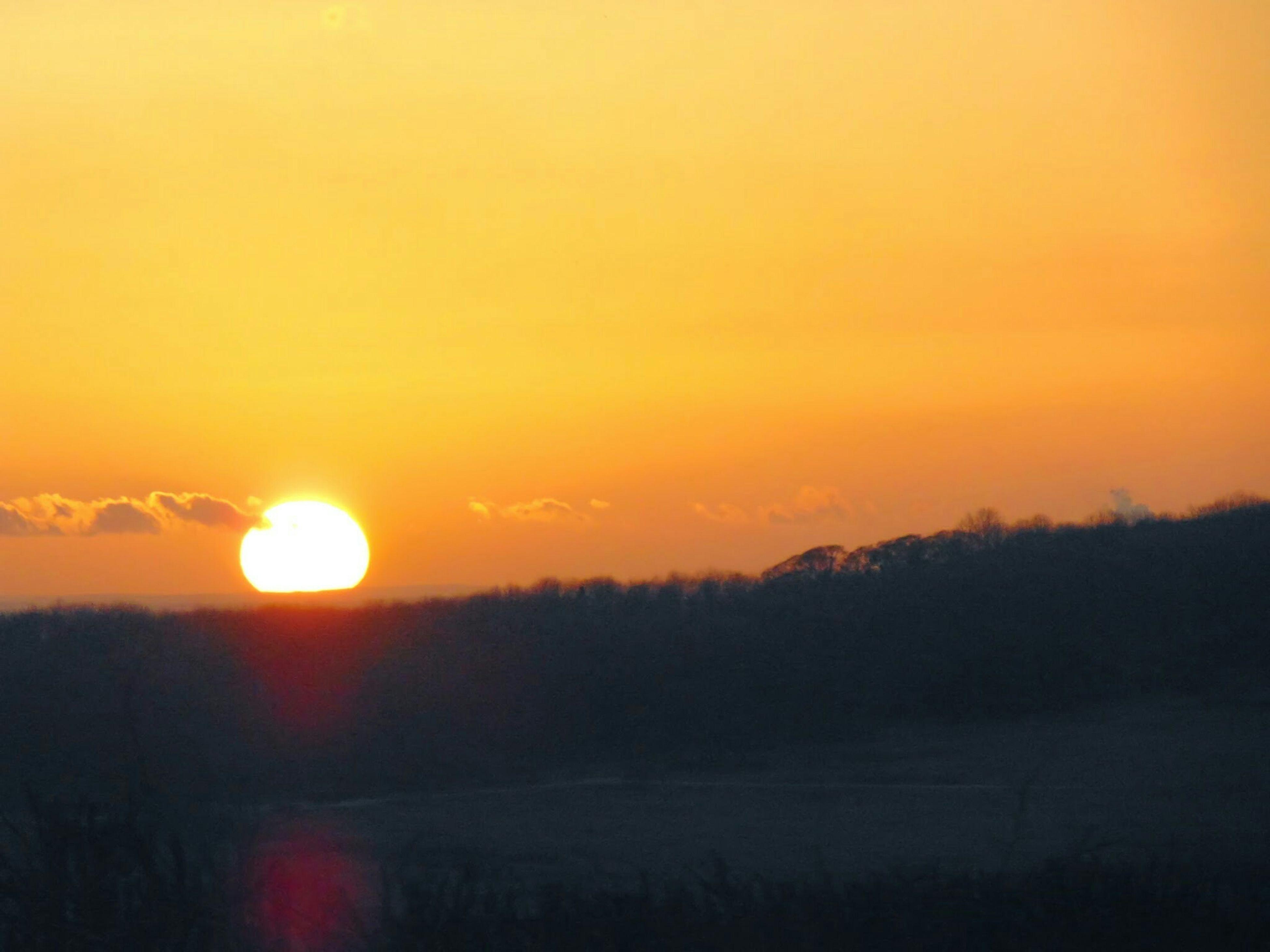 sunset, orange color, sun, tranquil scene, scenics, beauty in nature, tranquility, silhouette, landscape, idyllic, nature, sky, copy space, non-urban scene, sunlight, outdoors, field, clear sky, majestic, no people