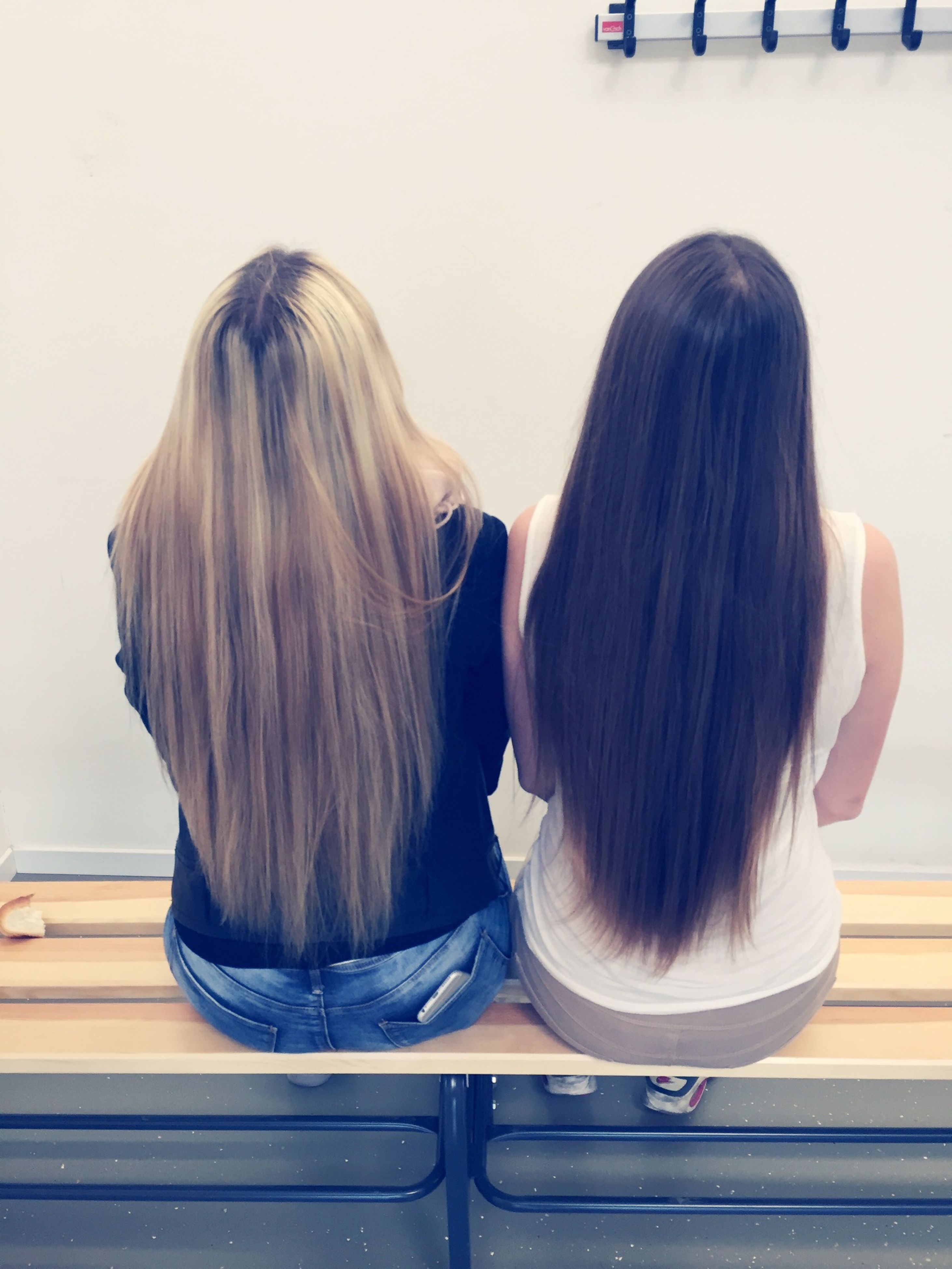 rear view, lifestyles, long hair, person, leisure activity, indoors, casual clothing, sitting, waist up, standing, young women, relaxation, side view, girls, full length, brown hair, blond hair