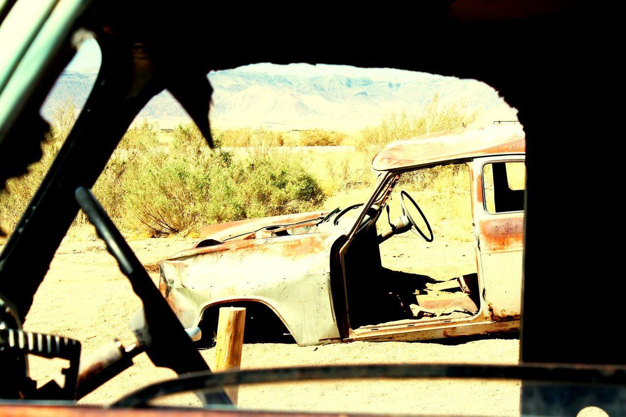 car, abandoned, damaged, day, transportation, land vehicle, no people, window, sunlight, steering wheel, outdoors, close-up